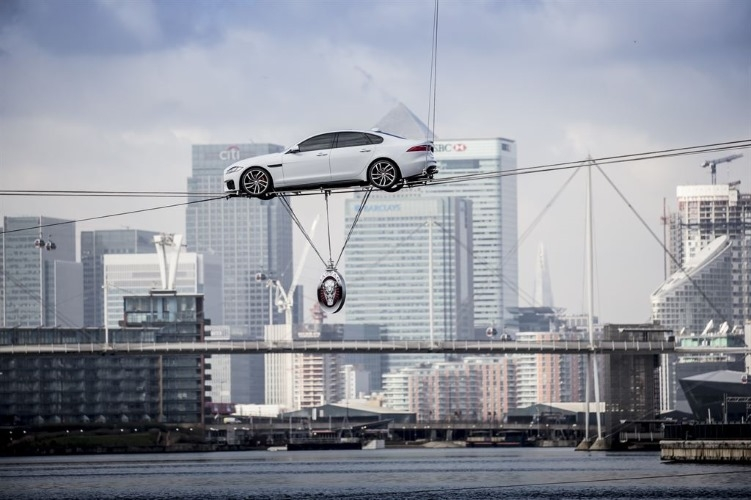 The new Jaguar XF performing world's longest high-wire water crossing