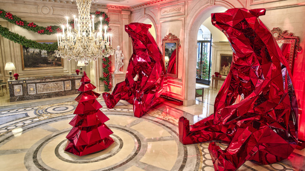 Designed by Leatham and produced by Michael Amann, these sculptures are entirely made from red glass.