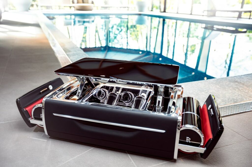The crystal champagne flutes in the Champagne Chest are arranged to mimic the V 12 engine